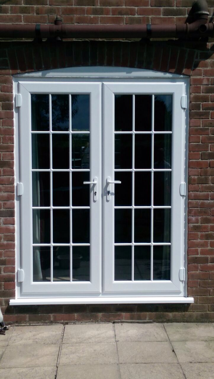 Upvc french doors with astragal bars window wizards for Upvc french doors dorset