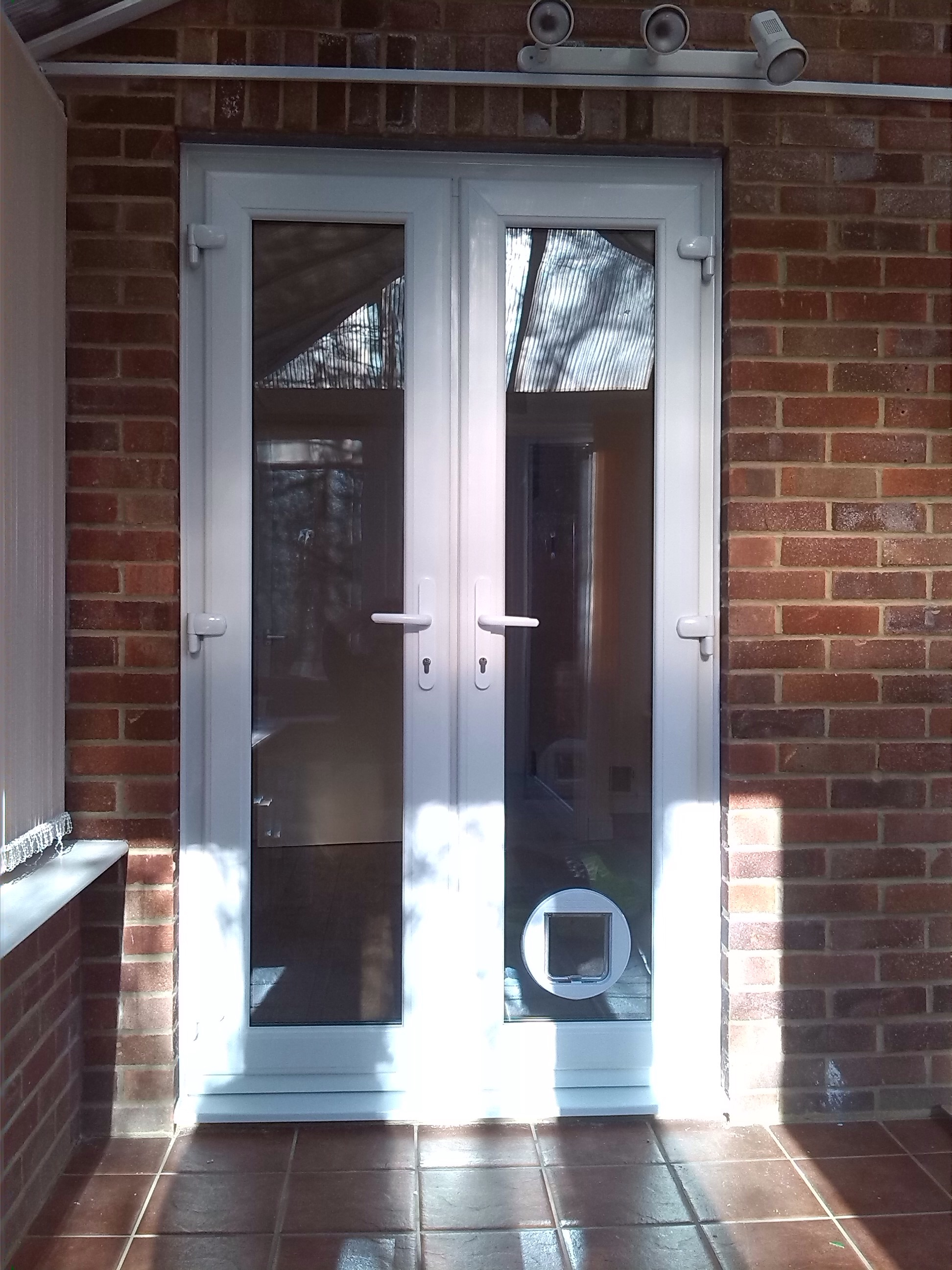 new upvc french doors and a cat flap installed window